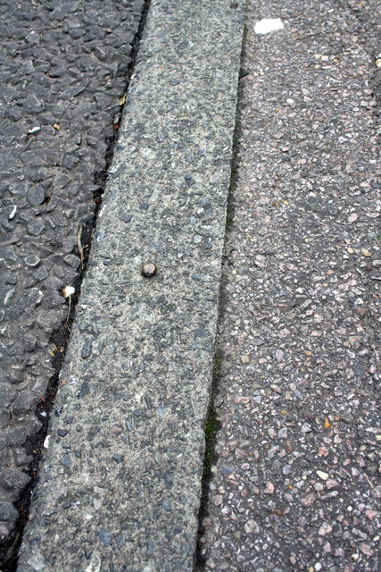 Benchmark on the kerb of Willingale Road