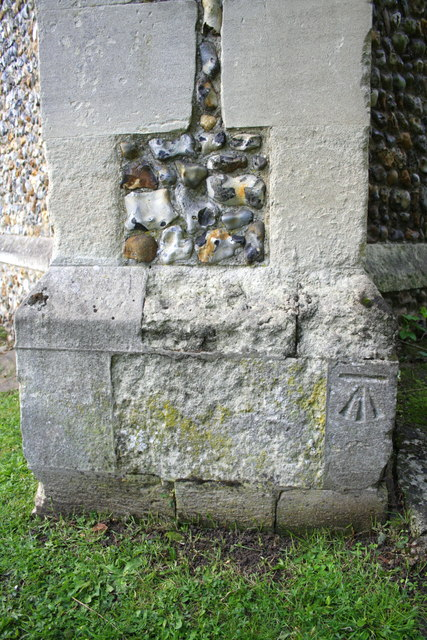 Benchmark on buttress of St Nicholas Loughton church