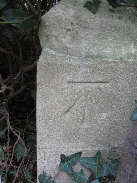 Cut bench mark on St James' church tower