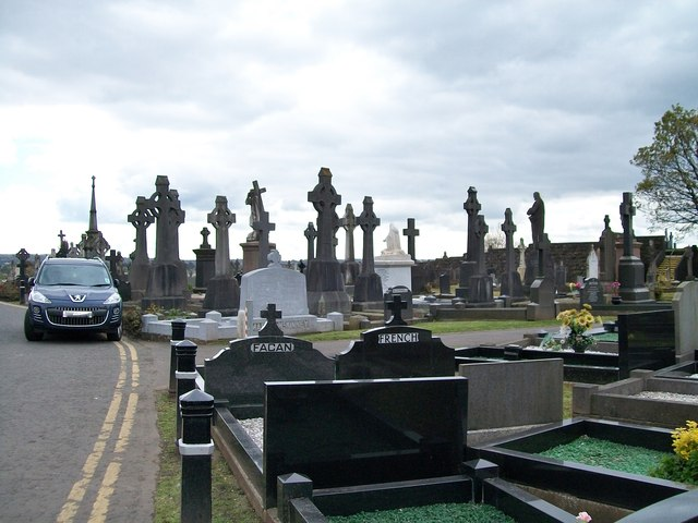 A forest of Celtic crosses beyond the entrance to Milltown Cemetery