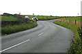 SJ9773 : Minor road junction by David Lally