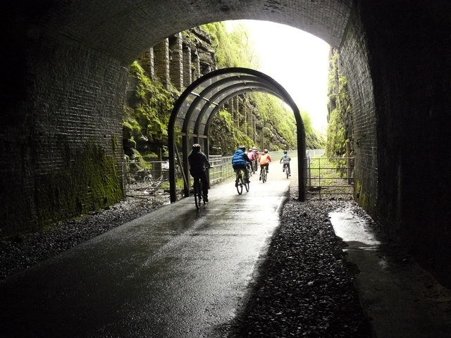 A group of cyclists leaving the Headstone Tunnel on the Monsal Trail