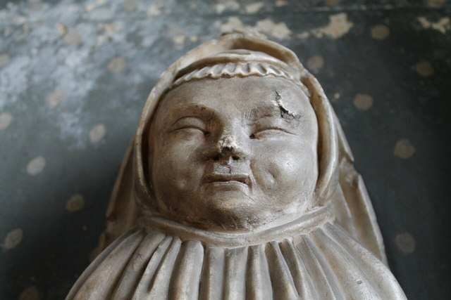 Detail of Baby, Manners memorial, All Saints', Bakewell