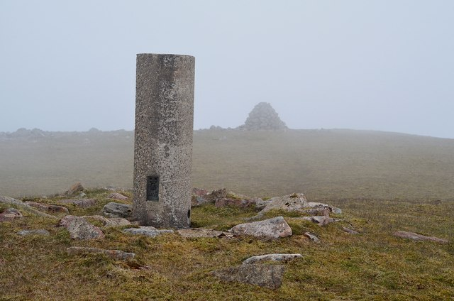 Trig point and cairn at the summit of Orval