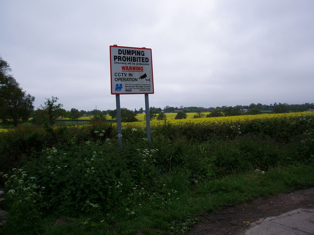 Hedgerow and No Dumping Sign