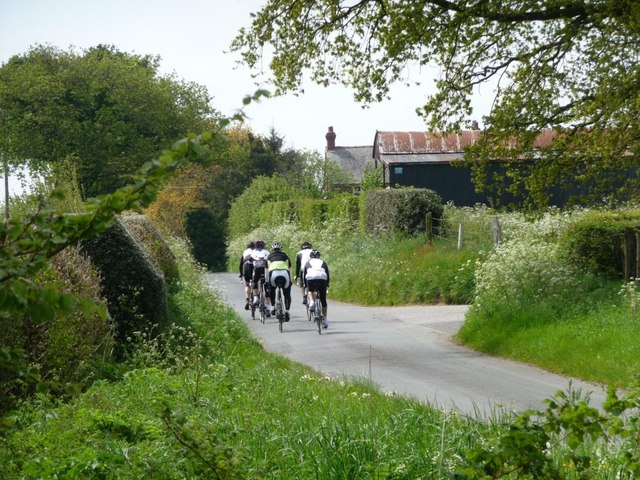 Cyclists approaching Roadside Farm, Buckden Lane