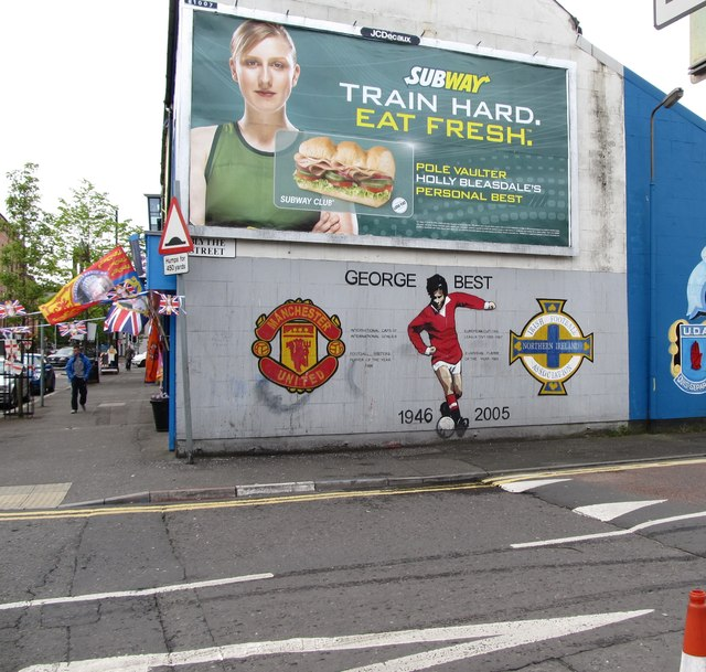 The George Best Memorial Mural on the gable end of The One Stop Ulster Shop