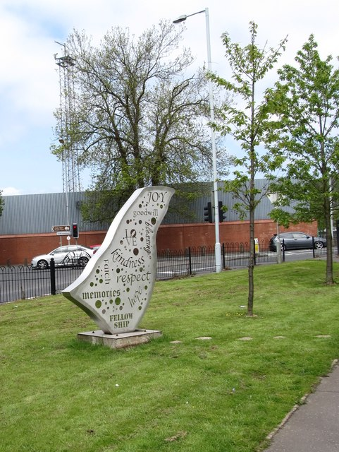 A piece of public art on green land at the junction of Blacks Road and Andersonstown Road