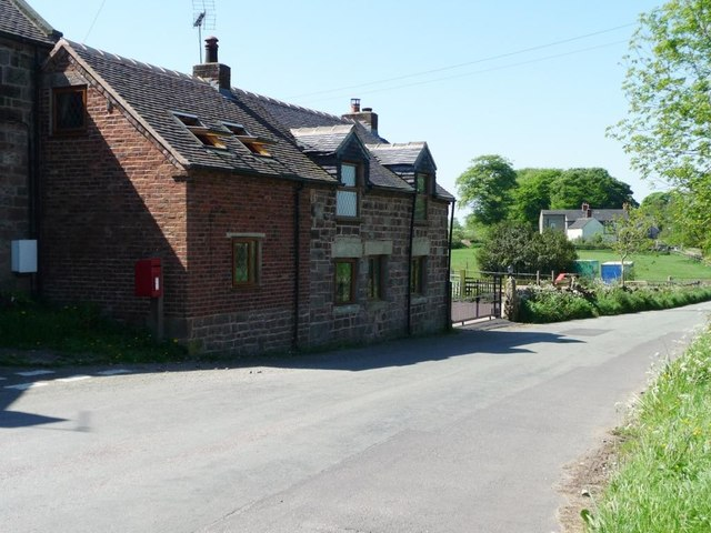 Post-box alongside a renovated cottage