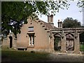 TF8943 : Almshouses at entrance to Holkham Park by John Brightley