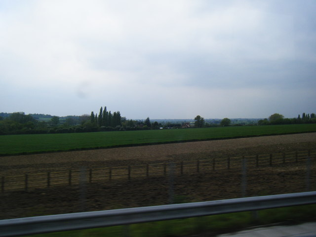View over farmland to Shalesmere Cottage from the M25