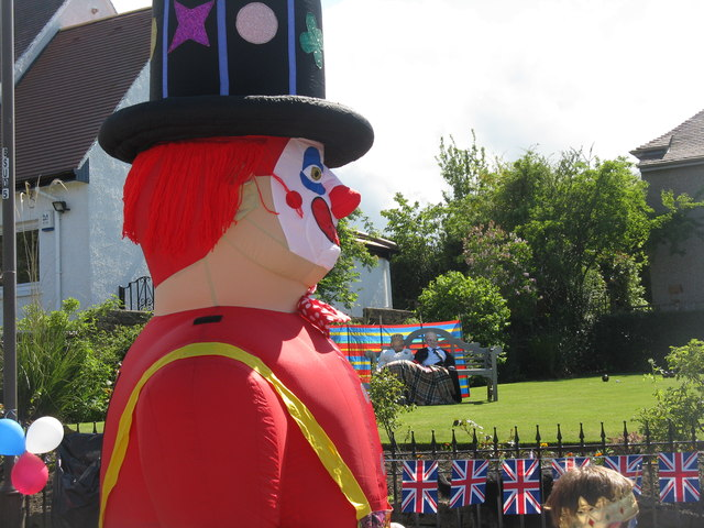 Clown, Her Majesty and his Royal Highness the Duke of Edinburgh at the Braid Hills Avenue street party