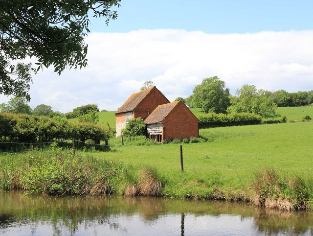Farm buildings by the canal