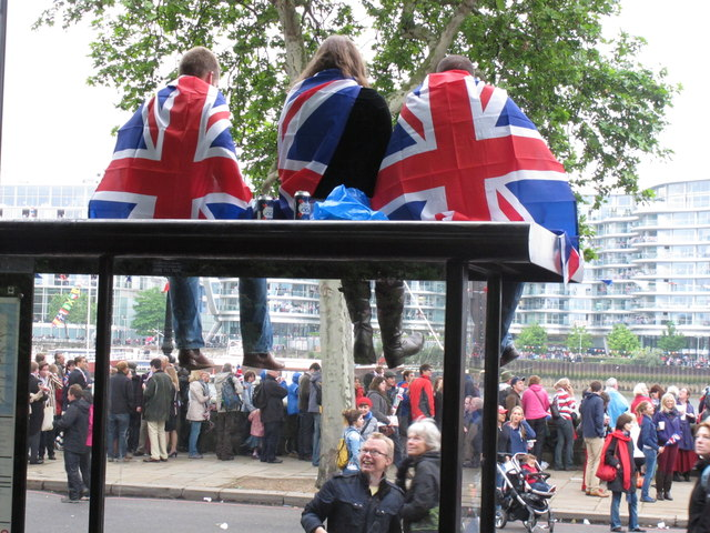 Diamond Jubilee Pageant - flag-draped lads up on a bus stop