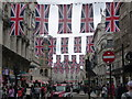 TQ2980 : London: Union flags over Coventry Street by Chris Downer