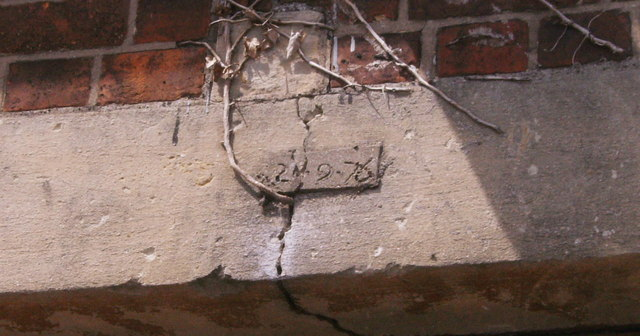 Date scratched into window lintel