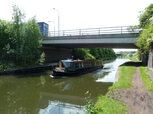 Bridgewater Canal with Europa Gate above, plus narrowboat