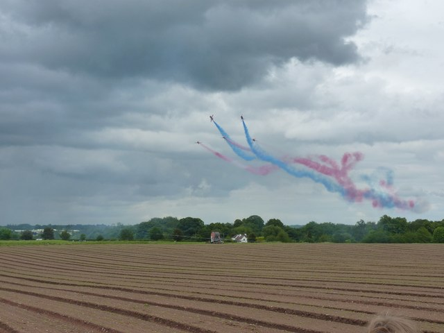 Red Arrows on a low-level run towards the airfield