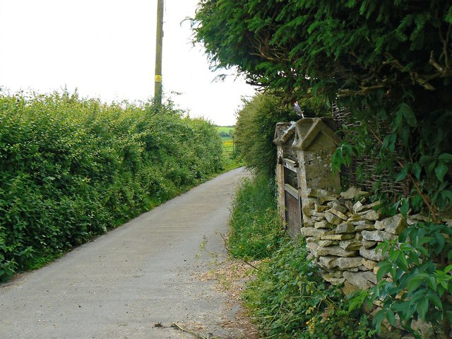 Gateway and road past Spring Cottage, Far Oakridge, near Frampton Mansell