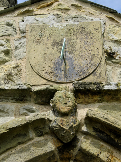 Sundial and St Peter over St Peter's church porch, Willerby
