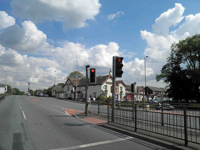 Waiting at the traffic lights across from The Swan public house, Bucklow Hill