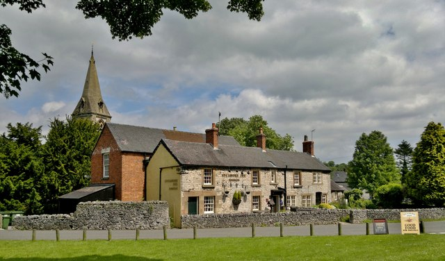 Sycamore Inn and shop, with St Peter's church, Parwich, Derbyshire