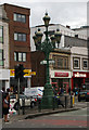 TQ2771 : Lamp standard and direction signs, Tooting Broadway by Julian Osley