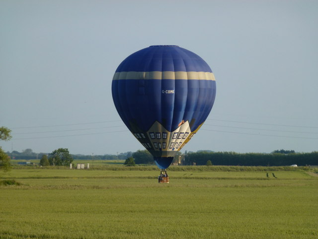 Hot air balloon flying very low near Westry, March