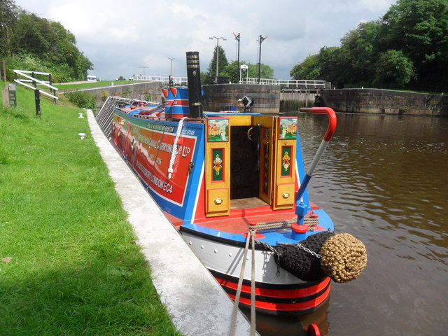 Working Narrow Boat Hadar moored below Dutton Locks.