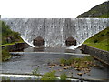 SN9264 : Overflow water tumbles down Caban Coch dam in the Elan Valley in late June by John Grayson