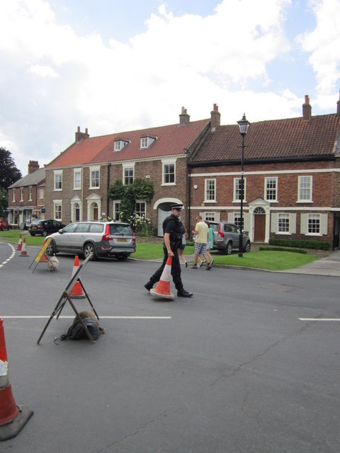 Armed policeman on cone duty