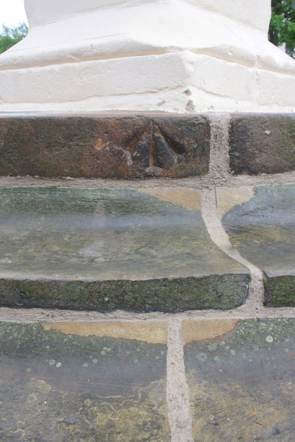 Benchmark on a step of the Market Place monument