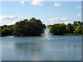 TQ5189 : Fountain in Raphael Park Lake by Robin Webster