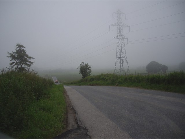Power lines crossing minor road
