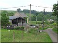 NY7686 : Barn and houses near Old Hall by Oliver Dixon