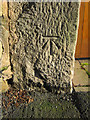 Dist:0.5km<br/>This bench mark is on the east gatepost outside Pendre Cottage in Gwernaffield Road. The mark is recorded on the 1871 O.S. Town Plan levelled at 409.6 feet.
