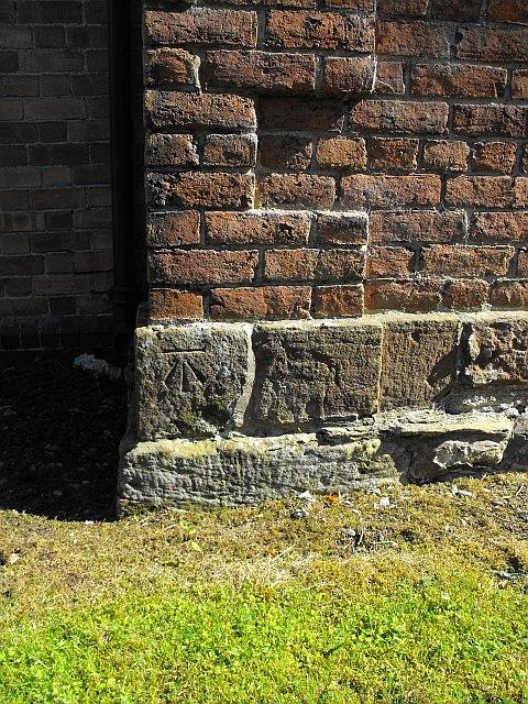 Benchmark on Llanllwchaiarn Parish Church