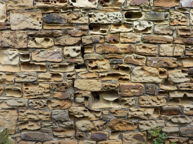 Weathered sandstone wall