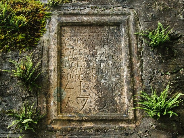 Mural tablet in ruined chapel