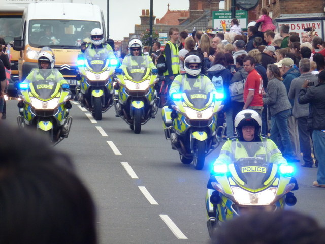 Winton: police motorcycles marshal the Olympic torch relay