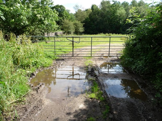 Muddy and gated field entrance