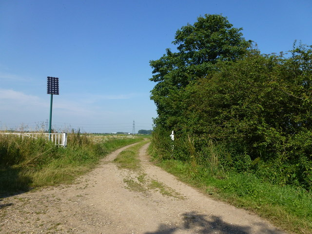 Gate and solar panel at the end of Low Gate, Moulton