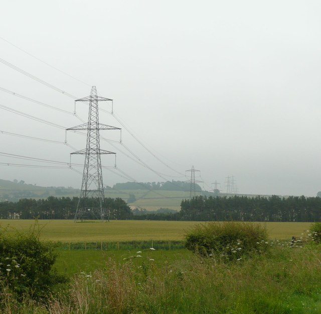 Pylons striding across the countryside