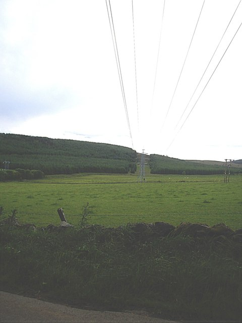 Power lines over the minor road from Cushnie