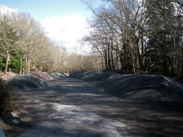 Stockpiled roadstone near Drum Bridge