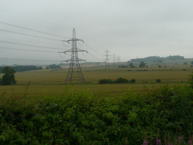 Pylons march across arable land
