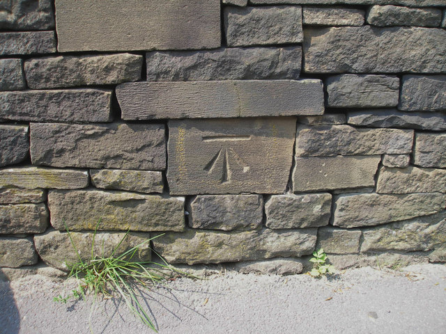 Cut benchmark on New Mill Road