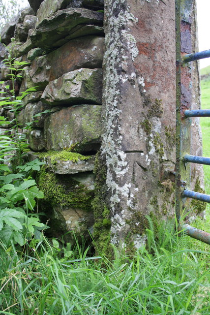 Benchmark on gatepost at Cow Dub