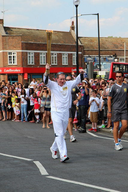 John Levison carries Olympic Torch in Southgate, London N14