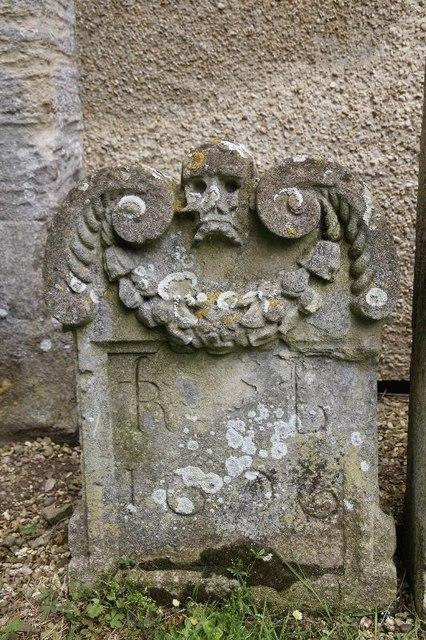 Grim headstone